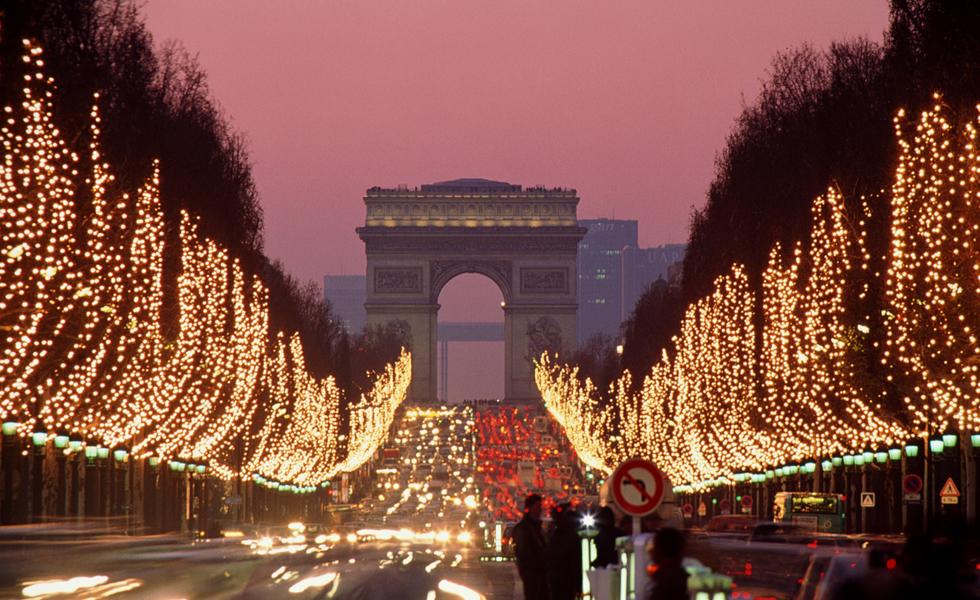 France, Paris, Champs-Elysees illuminated at dusk (long exposure)